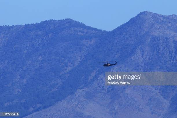 A photo taken from Turkey's Hatay province on January 31 2018 shows military helicopter as the Turkish Armed Forces hit PYD/PKK positions within the...