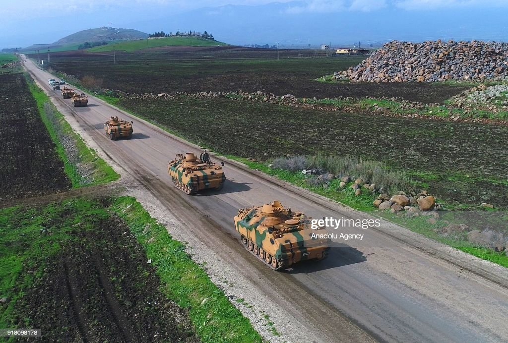 A photo taken from Turkey's Hatay province shows military vehicles are being transported to border units as artillery units of Turkish Armed Forces continue to hit PYD/PKK terror group targets across Turkey's Reyhanli, Kirikhan and Hassa districts, within the 'Operation Olive Branch' launched in Syria's Afrin, on February 14, 2018. Turkey launched Operation Olive Branch on January 20 in Syrias northwestern Afrin region; the aim of the operation is to establish security and stability along Turkish borders and the region as well as to eliminate PKK/KCK/PYD-YPG and Daesh terror groups, and protect the Syrian people from the oppression and cruelty of terrorists.