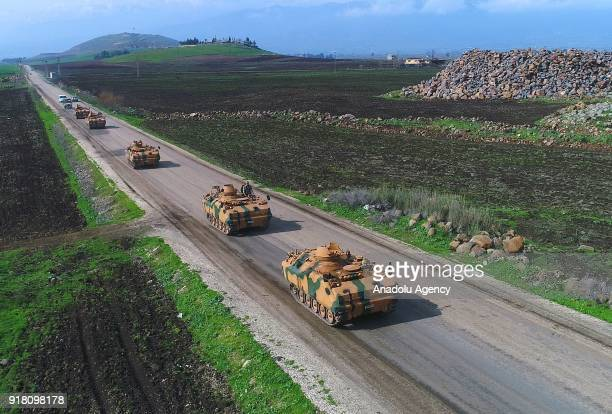 A photo taken from Turkey's Hatay province shows military vehicles are being transported to border units as artillery units of Turkish Armed Forces...