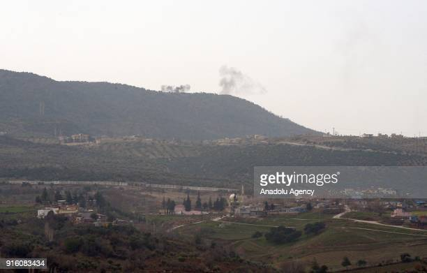 A photo taken from Turkey's Kilis province on February 9 2018 shows smokes rising as Turkish Army Forces continue to hit PYD/PKK terror group targets...