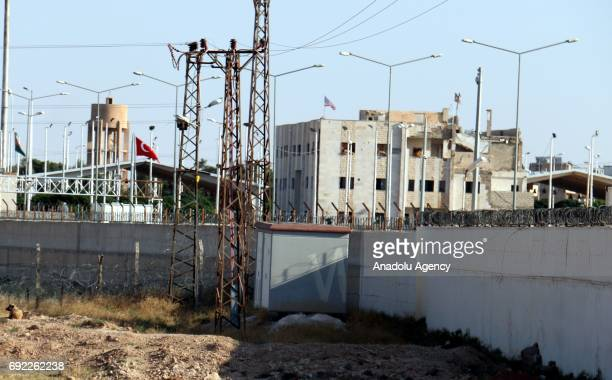 A photo taken from Turkey's Sanliurfa district shows American flags flying on top of a building that allegedly has PYD/ PKK terrorist organization...