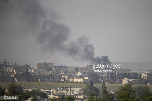 A photo taken from Turkey's Sanliurfa on October 11 2019 shows black smoke rising in Tell Abyad after terrorists burnt tires and diesel fuel to avoid...