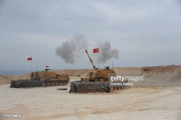 Photo taken from Turkey's Sanliurfa province, on October 09, 2019 shows Turkish Army's armored tanks artillery fire as Turkish troops along with the...