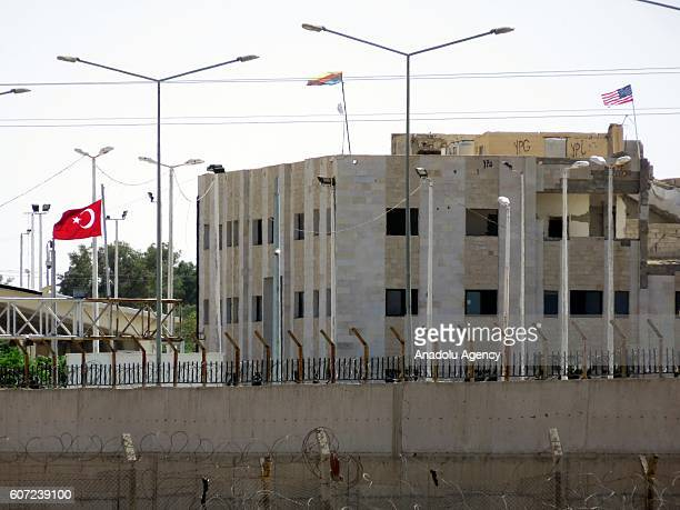 A photo taken from Turkey's Sanliurfa province shows an American flag flies on top of custom house that allegedly has PYD/ PKK terrorist organization...