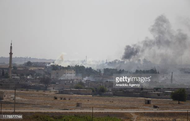 A photo taken from Turkey's Sanliurfa province shows dark smoke rising over Tal Abyad town after PKK terrorists and the Syrian Kurdish YPG militia...