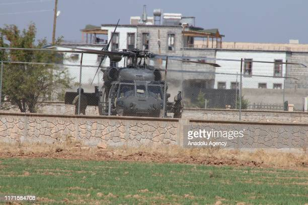 A photo taken from Turkey's Sanliurfa province shows the helicopters conducting seventh round of joint flights on September 28 2019 in Sanliurfa...