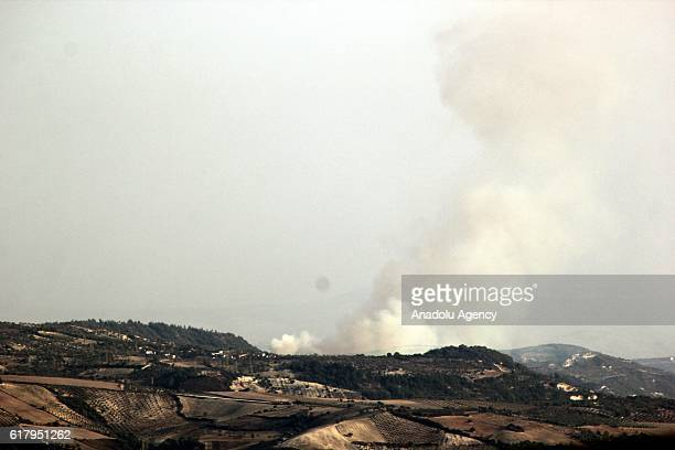 Photo taken from Yayladagi district of Turkey's Hatay province shows that smoke rises as warcrafts belonging to Syrian and Russian army carry out...