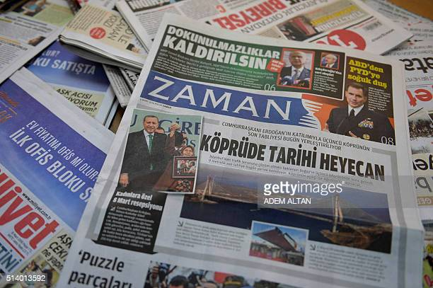 TOPSHOT A photo taken in Ankara on March 6 2016 shows the front page of the first new edition of the Turkish daily newspaper Zaman which had...