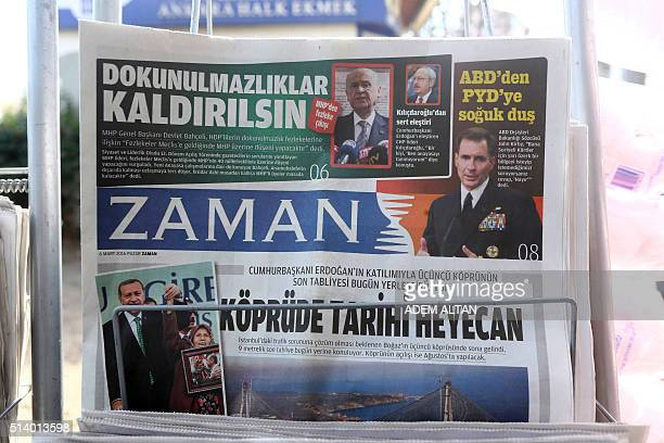 A photo taken in Ankara on March 6 2016 shows the front page of the first new edition of the Turkish daily newspaper Zaman which had staunchly...