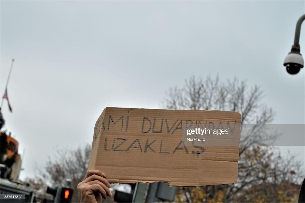 A photo taken in Ankara, Turkey on December 7, 2017 shows a placard as Turkish Muslims take part in a protest near the U.S. Embassy against its president Donald Trump's officially recognition the city of Jerusalem as the capital of Israel on December 6.