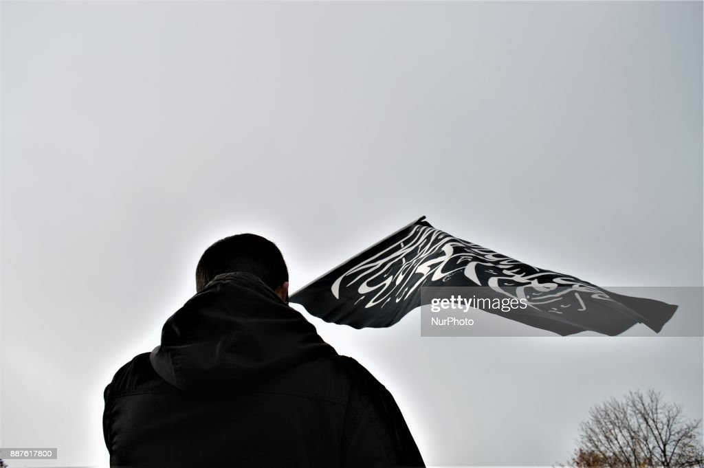 A photo taken in Ankara, Turkey on December 7, 2017 shows a protester waving a black flag with Arabic letters as Turkish Muslims take part in a protest near the U.S. Embassy against its president Donald Trump's officially recognition the city of Jerusalem as the capital of Israel on December 6.
