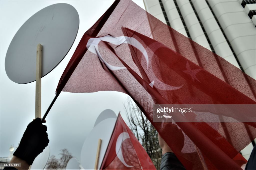 A photo taken in Ankara, Turkey on December 7, 2017 shows a protester waving a Turkish flag as Turkish Muslims take part in a protest near the U.S. Embassy against its president Donald Trump's officially recognition the city of Jerusalem as the capital of Israel on December 6.