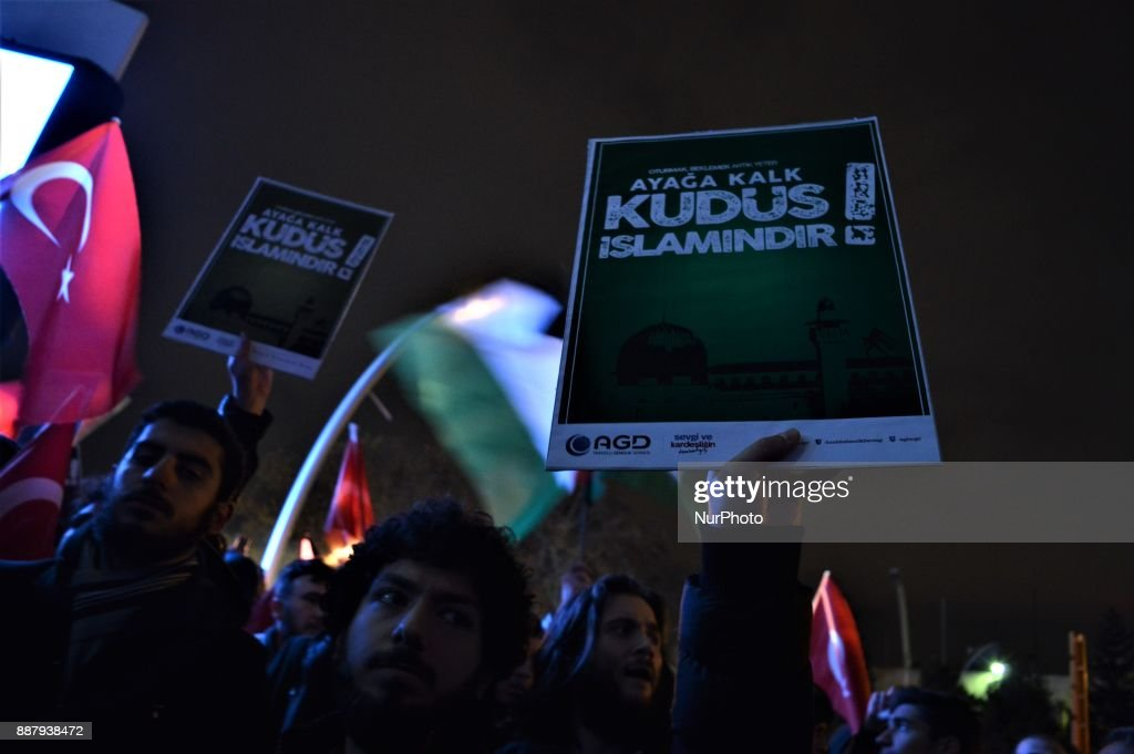 A photo taken in Ankara, Turkey on December 7, 2017 shows a protester holding a placard as Turkish Muslims take part in a protest near the U.S. Embassy against its president Donald Trump's official recognition the city of Jerusalem as the capital of Israel on December 6.
