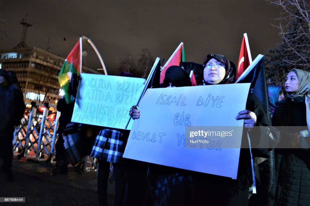 A photo taken in Ankara, Turkey on December 7, 2017 shows protesters holding placards as Turkish Muslims take part in a protest near the U.S. Embassy against its president Donald Trump's official recognition the city of Jerusalem as the capital of Israel on December 6.