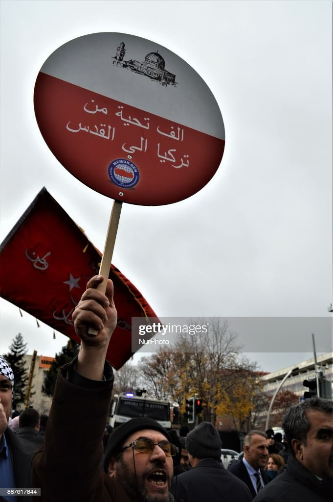 A photo taken in Ankara, Turkey on December 7, 2017 shows that a protester holding a placard chants slogans as Turkish Muslims take part in a protest near the U.S. Embassy against its president Donald Trump's officially recognition the city of Jerusalem as the capital of Israel on December 6.