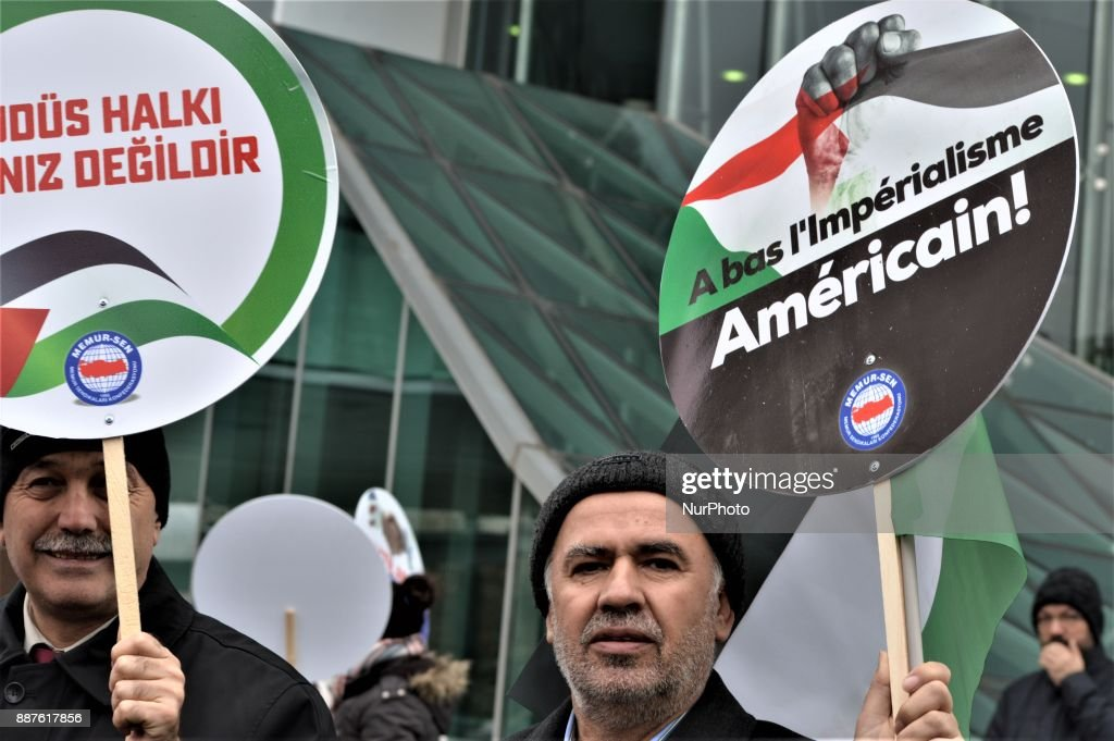 A photo taken in Ankara, Turkey on December 7, 2017 shows that a man holding a placard pose for a photo as Turkish Muslims take part in a protest near the U.S. Embassy against its president Donald Trump's officially recognition the city of Jerusalem as the capital of Israel on December 6.