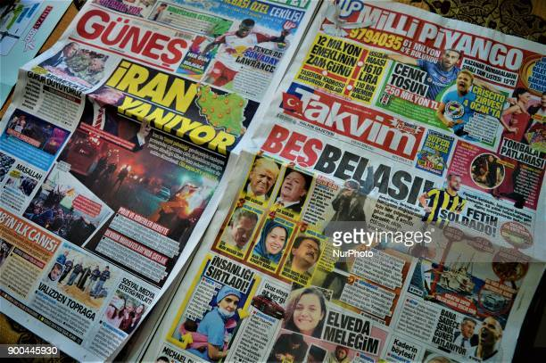 A photo taken in Ankara Turkey on January 2 2018 shows Turkish progovernment daily newspapers reacting over protests against the Iranian government...