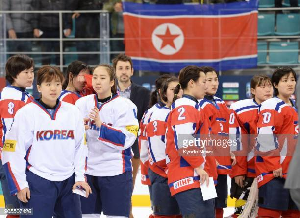 Photo taken in April 2017 shows North and South Korean ice hockey players after a game in Gangneung South Korea The South has proposed a joint...