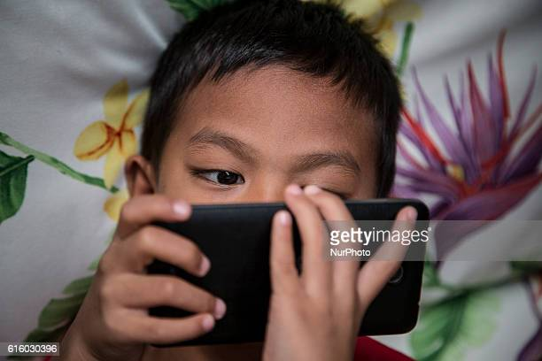 Photo taken in Bogor Indonesia on 25 September 2016 show A child looking for internet on mobile phone Story of Darkside of Internet cause to Children...