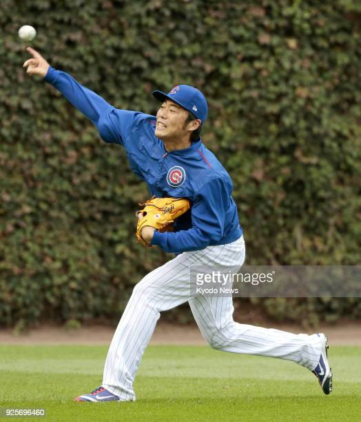 Photo taken in Chicago Illinois on Oct 11 shows free agent reliever Koji Uehara playing catch when he was with the Chicago Cubs Uehara has said he...