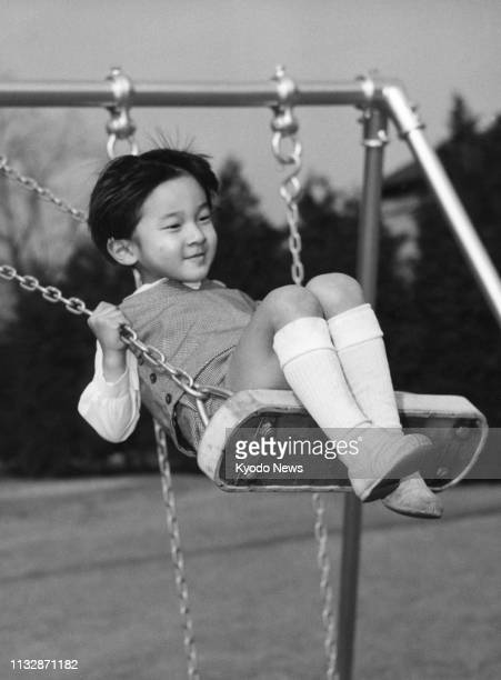 Photo taken in February 1965 shows Prince Hiro now Japanese Crown Prince Naruhito playing on a swing at the Togu Palace in Tokyo Crown Prince...