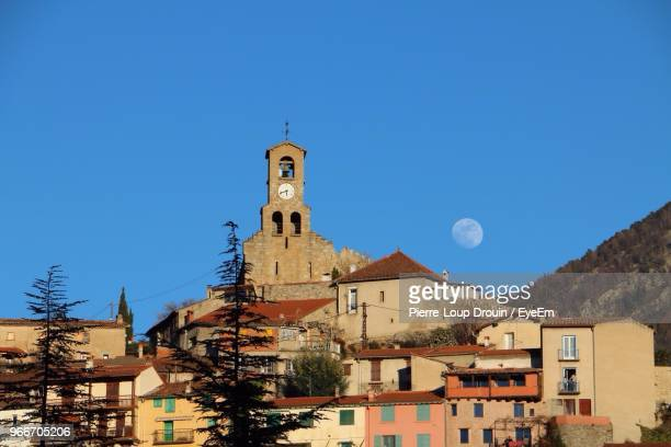 tower in town against clear sky at dusk - perpignan stock photos and pictures