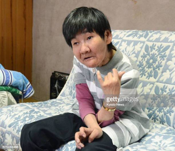 Photo taken in June 2017 in the southwestern Japan city of Minamata shows Shinobu Sakamoto a Minamata disease patient who will visit Switzerland in...