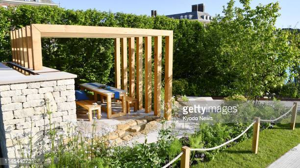 "Photo taken in London on May 21 shows the ""Kampo no Niwa"" by Japanese garden designers Kazuto Kashiwakura and Miki Sato, a gold medal-winning garden..."