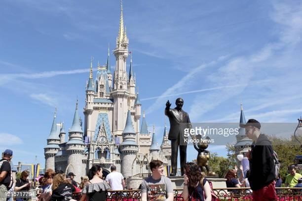 Photo taken in March 2018 shows Magic Kingdom Park at Walt Disney World Resort in Orlando, Florida. Disney World plans to reopen beginning July 11...