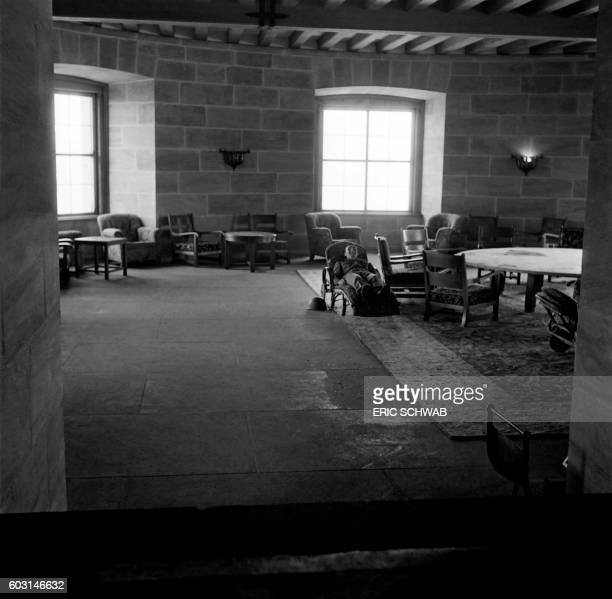 Photo taken in May 1945 shows a US soldier in the living room of the Berghof Adolf Hitler's home in the Obersalzberg of the Bavarian Alps near...