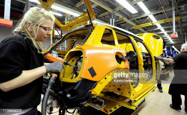 Photo taken in May 2014 shows a woman working at a BMW factory producing Minis in Oxford Britain ==Kyodo