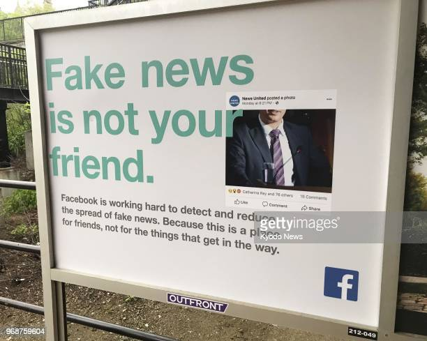 Photo taken in May 2018 shows a poster put up by Facebook Inc in New York to raise awareness about fake news ==Kyodo