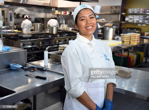 Photo taken in Melbourne on 25 May, 2020 shows volunteer chef and international student Laarni Byrne from the Philippines at the Melbourne City...