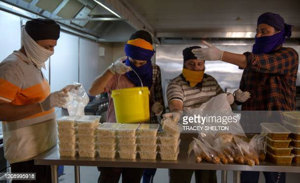 Photo taken in Melbourne on March 27, 2020 shows volunteers preparing food deliveries as Sikh temples across Melbourne have become one of the centres...