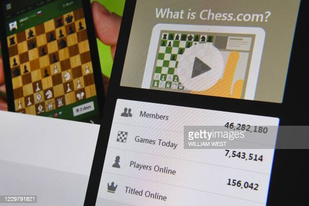 A photo taken in Melbourne on November 25 2020 shows the web page of Chesscom showing more than 46 million members with 75 million matches played...