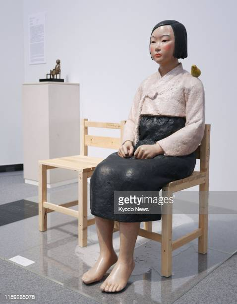 "Photo taken in Nagoya, central Japan, on Aug. 3 shows a statue symbolizing ""comfort women,"" who were forced to work in wartime Japanese military..."