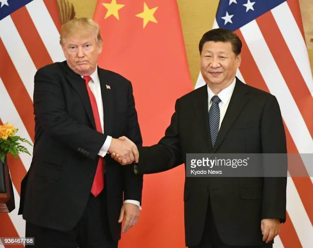 Photo taken in Nov 9 shows US President Donald Trump and Chinese President Xi Jinping shaking hands during a joint press conference at the Great Hall...