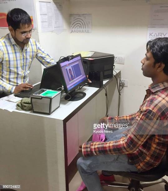 Photo taken in November 2017 shows a man registering for the Aadhaar India's new identification database system in New Delhi ==Kyodo