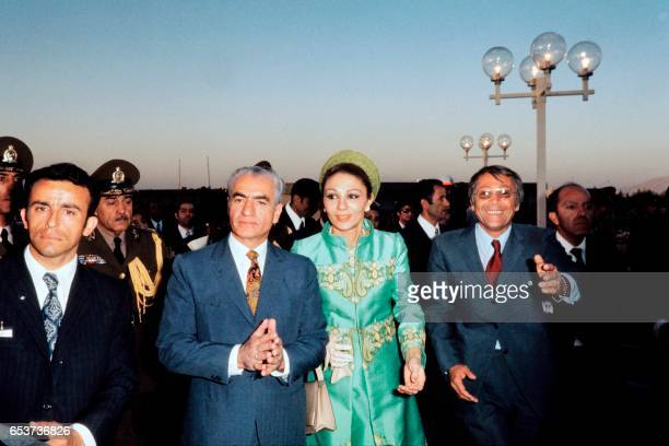 Photo taken in October 1971 shows Chah Mohammad Reza Palhavi and his wife Iranian Empress Farah Diba arriving at a commemoration of the 2500th...
