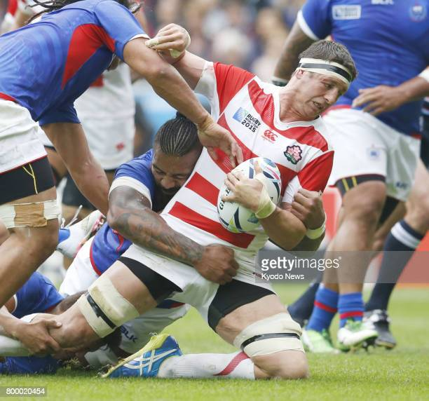 Photo taken in October 2015 shows Luke Thompson holding onto the ball during the first half of Japan's 26-5 win over Samoa in a Rugby World Cup pool...