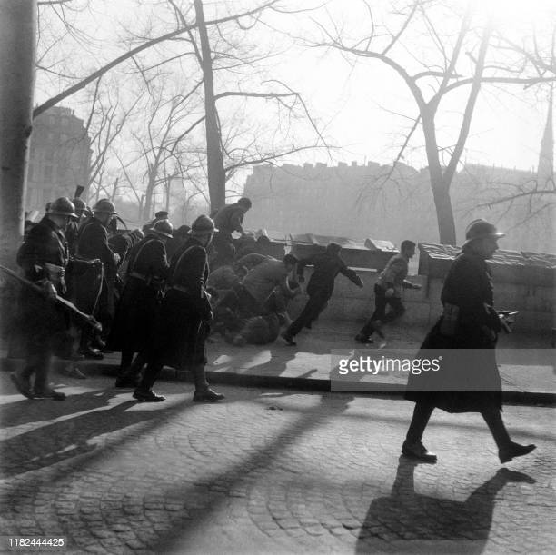 Photo taken in Paris on March 9 1956 of the demonstration of Algerian workers on strike at the call of the Algerian National Movement led by the...