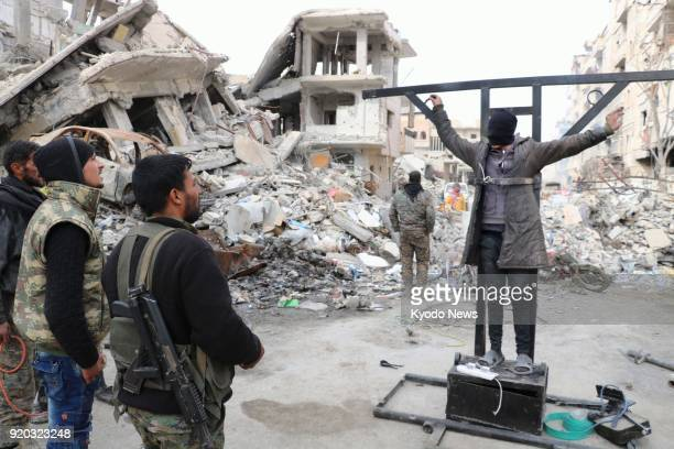 Photo taken in Raqqa northern Syria on Feb 15 2018 shows Kurdishled forces explaining how Islamic State fighters executed and tortured people in...