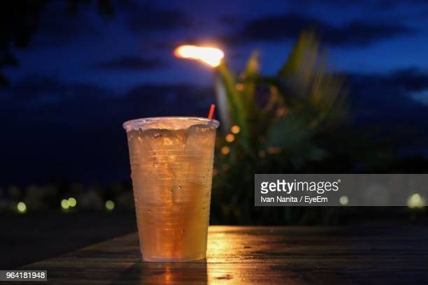 Close-Up Of Drink On Table At Night