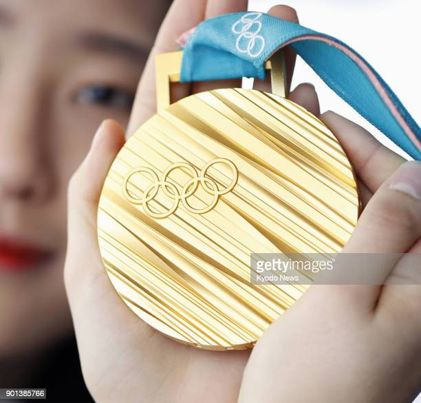 A photo taken in Seoul South Korea on Dec 24 2017 shows a Pyeongchang Winter Olympics gold medal ==Kyodo