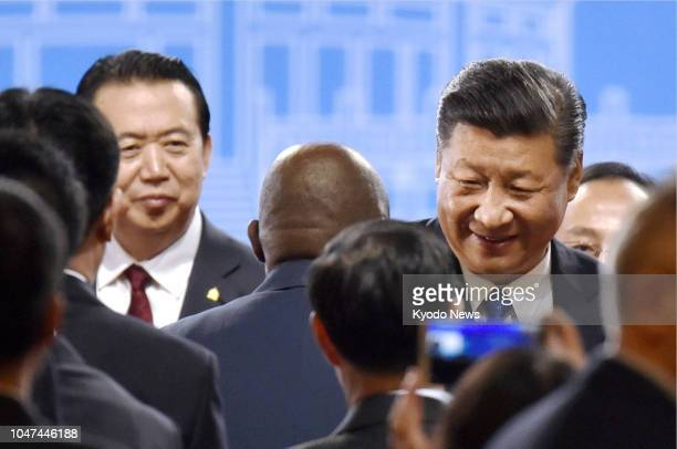 Photo taken in September 2017 shows Interpol President Meng Hongwei alongside Chinese President Xi Jinping attending an annual meeting of the...