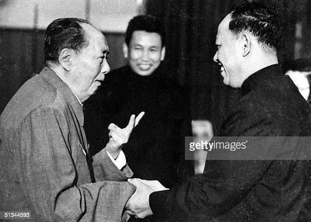 A photo taken in the 1970's outside of Cambodia shows China's chairman Mao Zedong greeting top Khmer Rouge official Ieng Sary also known as brother...