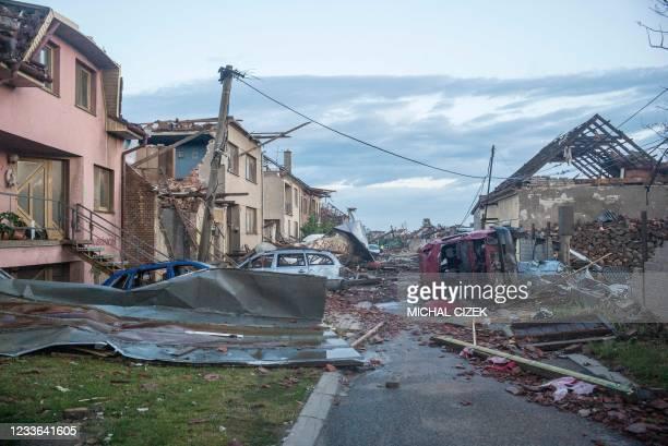 Photo taken in the early morning on June 25, 2021 shows the debris of damaged buildings in the village of Moravska Nova Ves, 60 km south of Brno,...