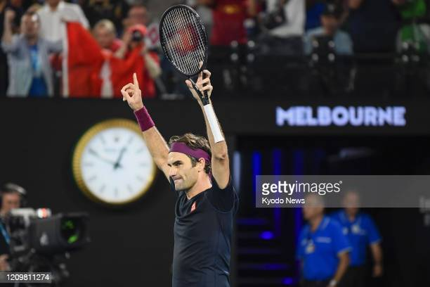 Photo taken in the small hours of Jan 25 shows Roger Federer of Switzerland celebrating after beating John Millman of Australia in the third round of...