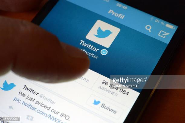 A photo taken in the western French city of Rennes on November 7 2013 shows an official Twitter account on a smartphone Twitter will make its Wall...