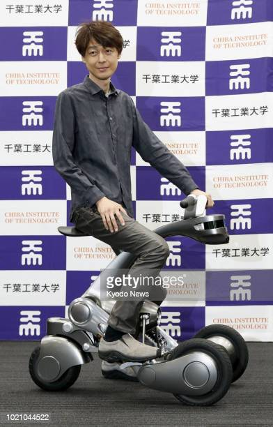Photo taken in Tokyo on July 4 shows Takayuki Furuta general manager of Chiba Institute of Technology's Future Robotics Technology Center posing on...